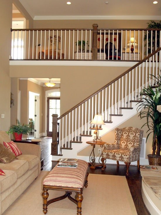 Wooden staircase leading to the second-floor loft and sleeping quarters.