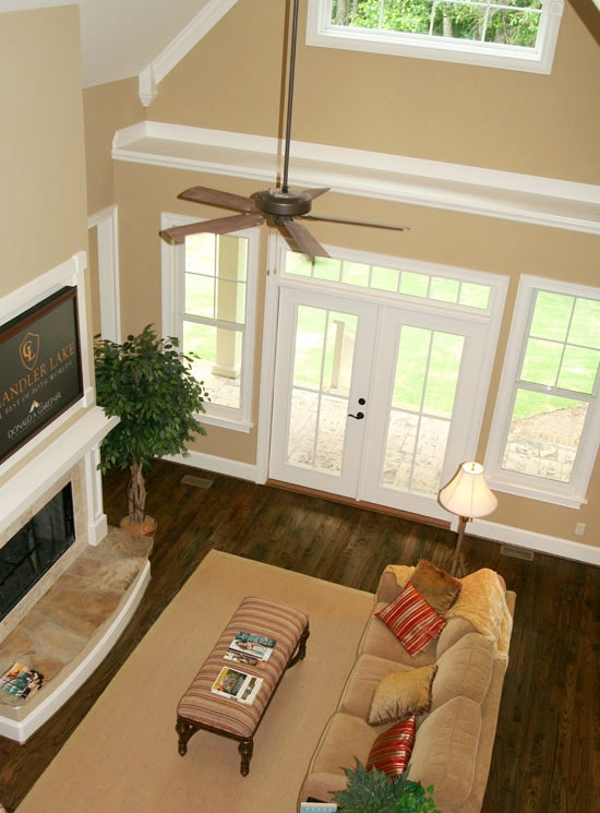 Top view of the living room showing the dark hardwood flooring and a french door that opens out to the back porch.