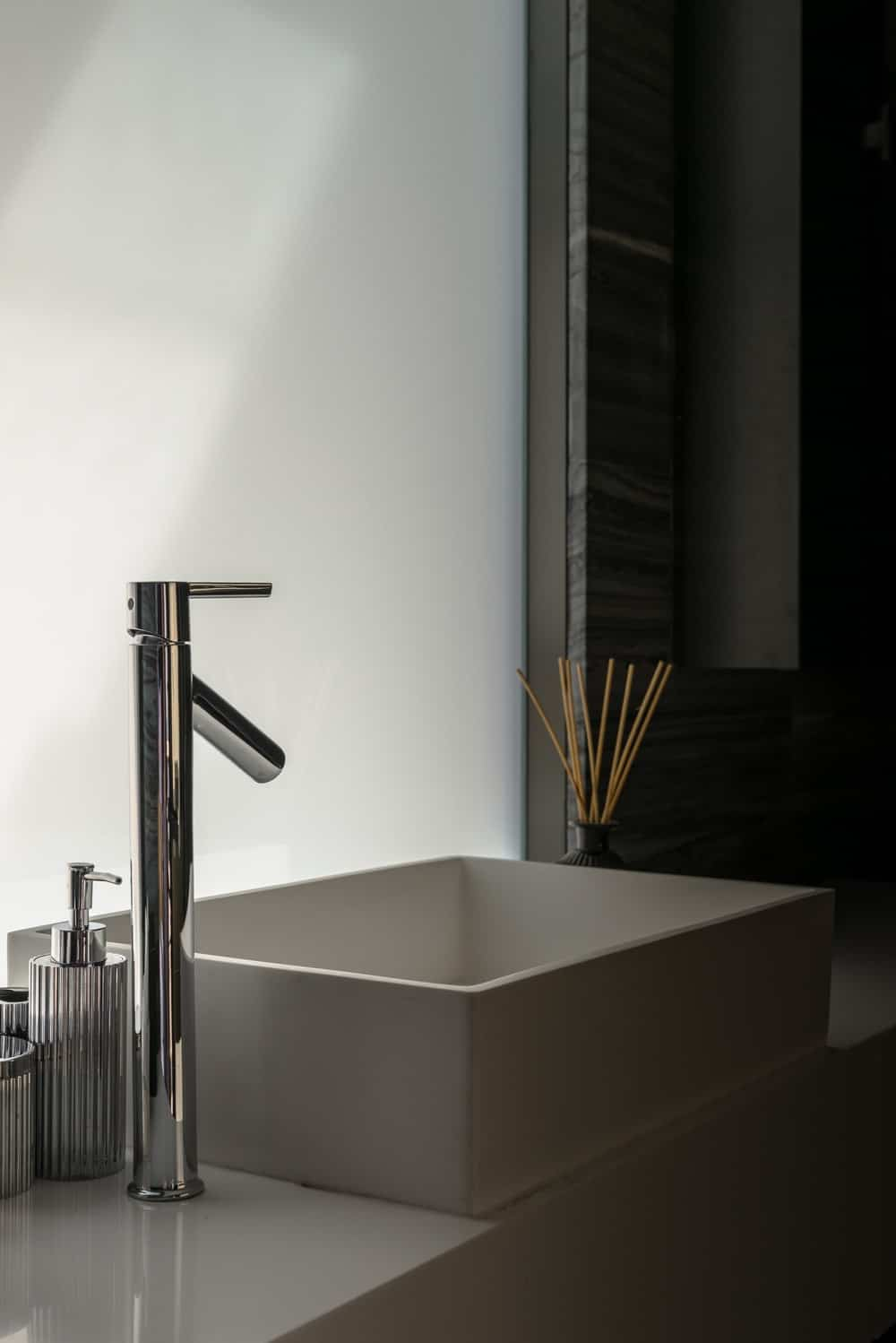 The opaque glass panel still allows an abundance of natural lighting to go into the bathroom.
