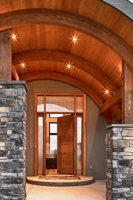 A closer look shows the wooden front door surrounded by frosted glass panels.