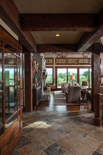 The foyer has a great view of the living room and the outdoors via the enormous windows.