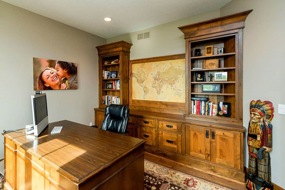 A framed world map along with a mother and daughter canvas adorns the light gray walls.