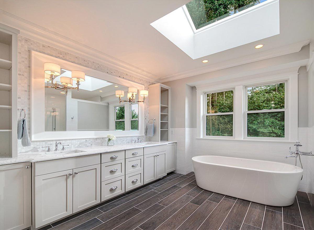 White framed windows and skylight invite natural light in.