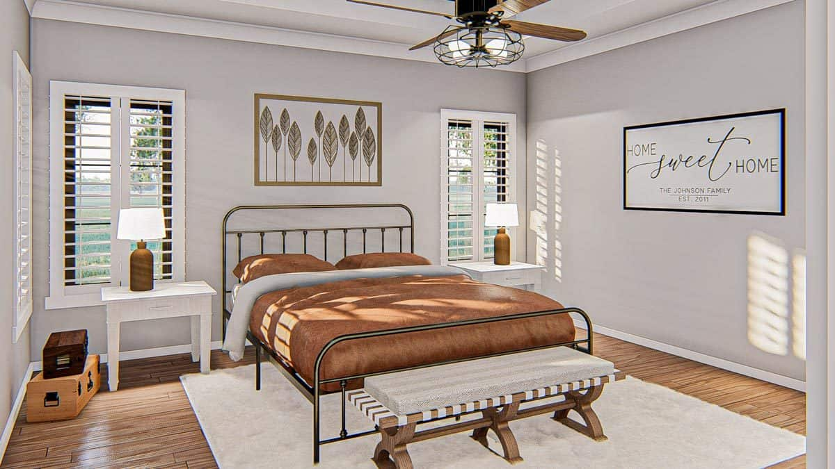 The primary bedroom has a metal bed, cushioned bench, white nightstands, a ceiling fan, and framed artworks.