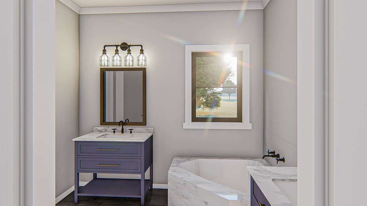 Primary bathroom with separate his and her vanities along with a corner tub clad in white marble.