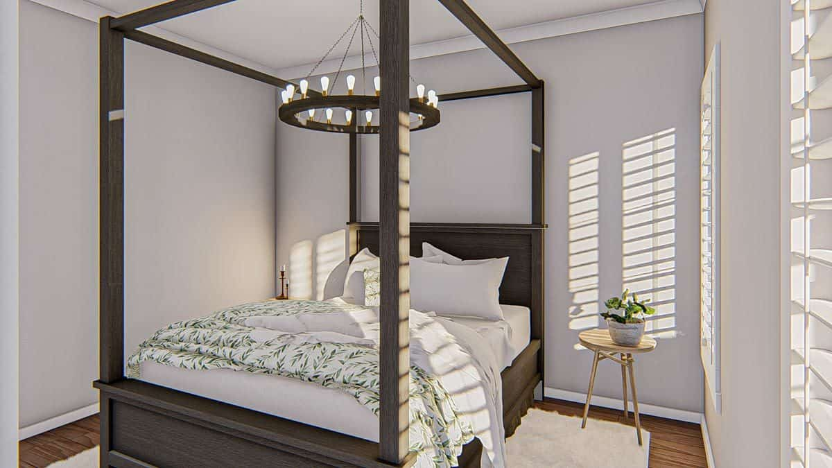 This bedroom offers white louvered windows, light wood nightstands, and a canopy bed lit by a round chandelier.