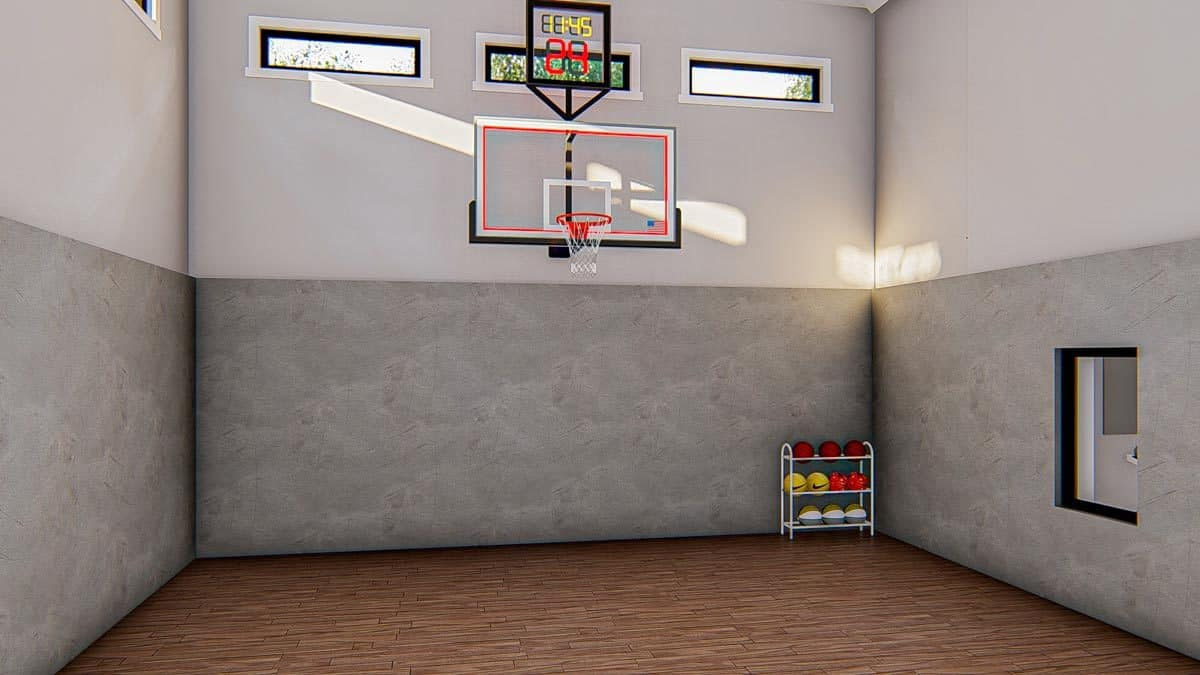 The sport court has hardwood flooring and two-tone walls mounted with a basketball ring.