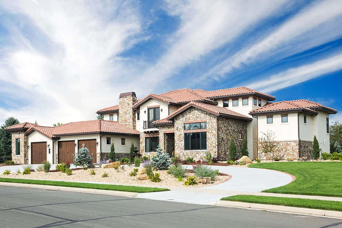 5-Bedroom Two-Story Spanish Home with Main Level Primary Suite