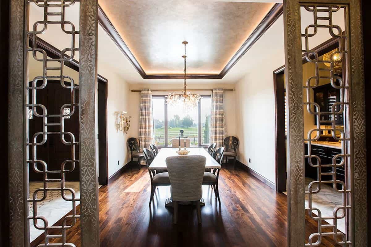 View of the formal dining room from the ornate doorway.