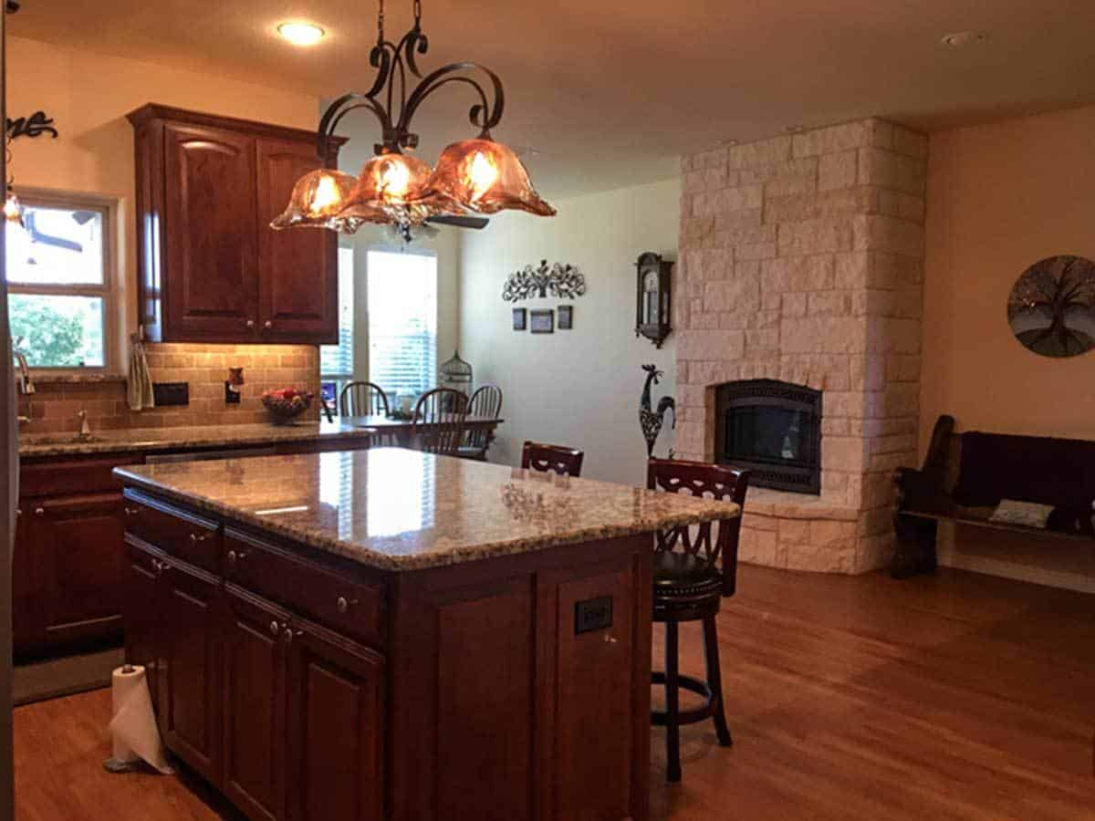 A stone fireplace warms both the kitchen and breakfast room.