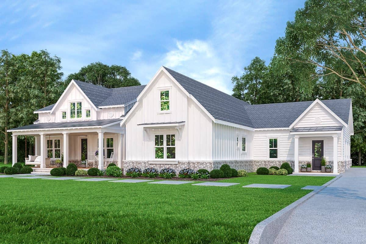 Front exterior view with board and batten siding, white columns, stone bases, and covered porches.