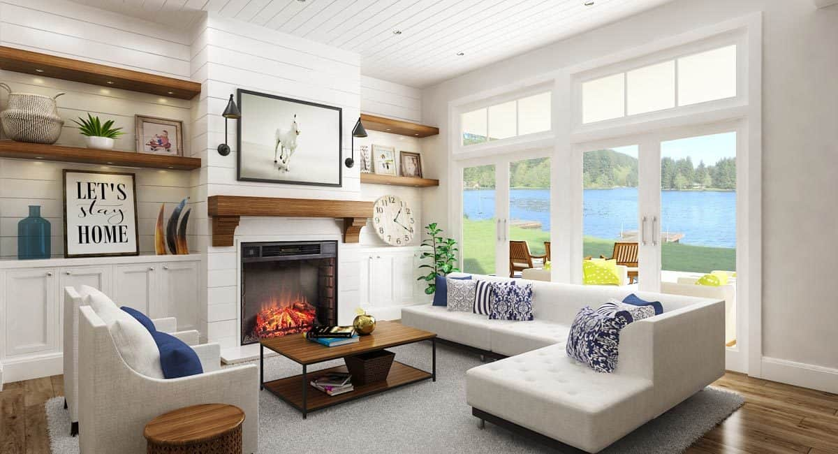The living room has gray seats, floating shelves, wooden tables, white built-ins, and a pair of french doors that lead out to the back porch.