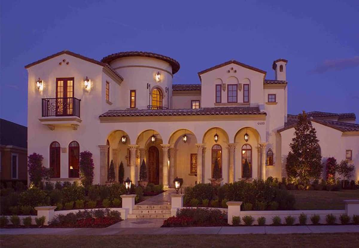 Home facade during the night showing its warm glow coming from the outdoor sconces and lamps.