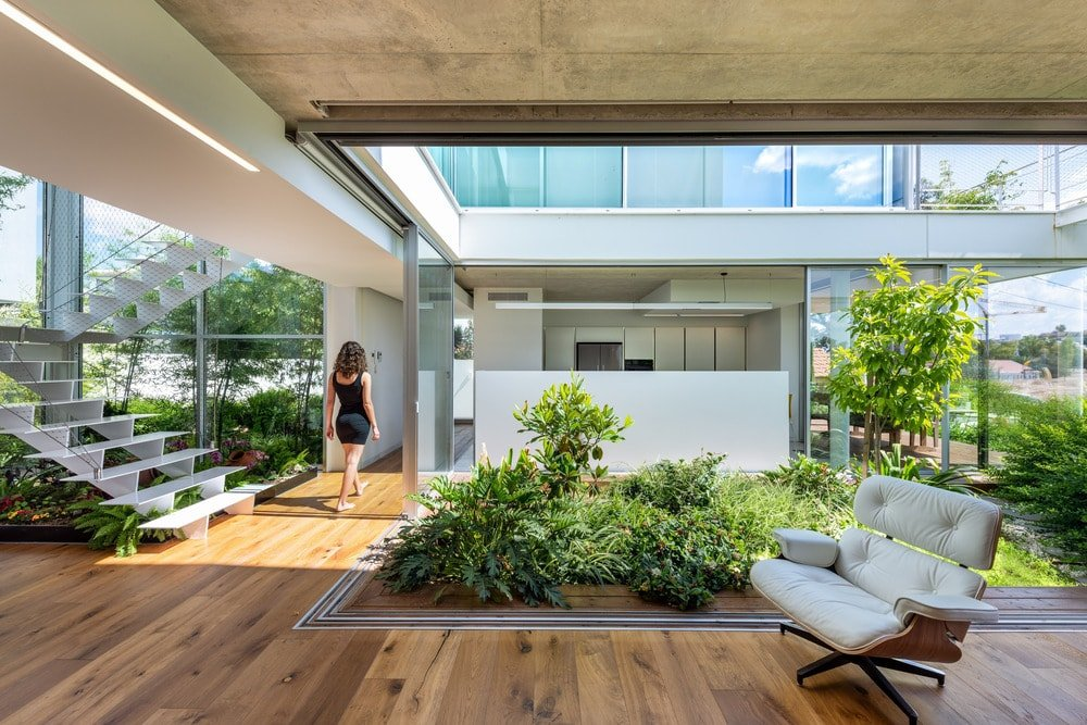 With the glass doors receded into the walls, the interior and exterior landscaping of the house mesh together into a unique aesthetic.