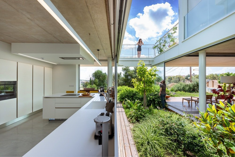 A few steps from the living room is the kitchen across through the middle landscape.