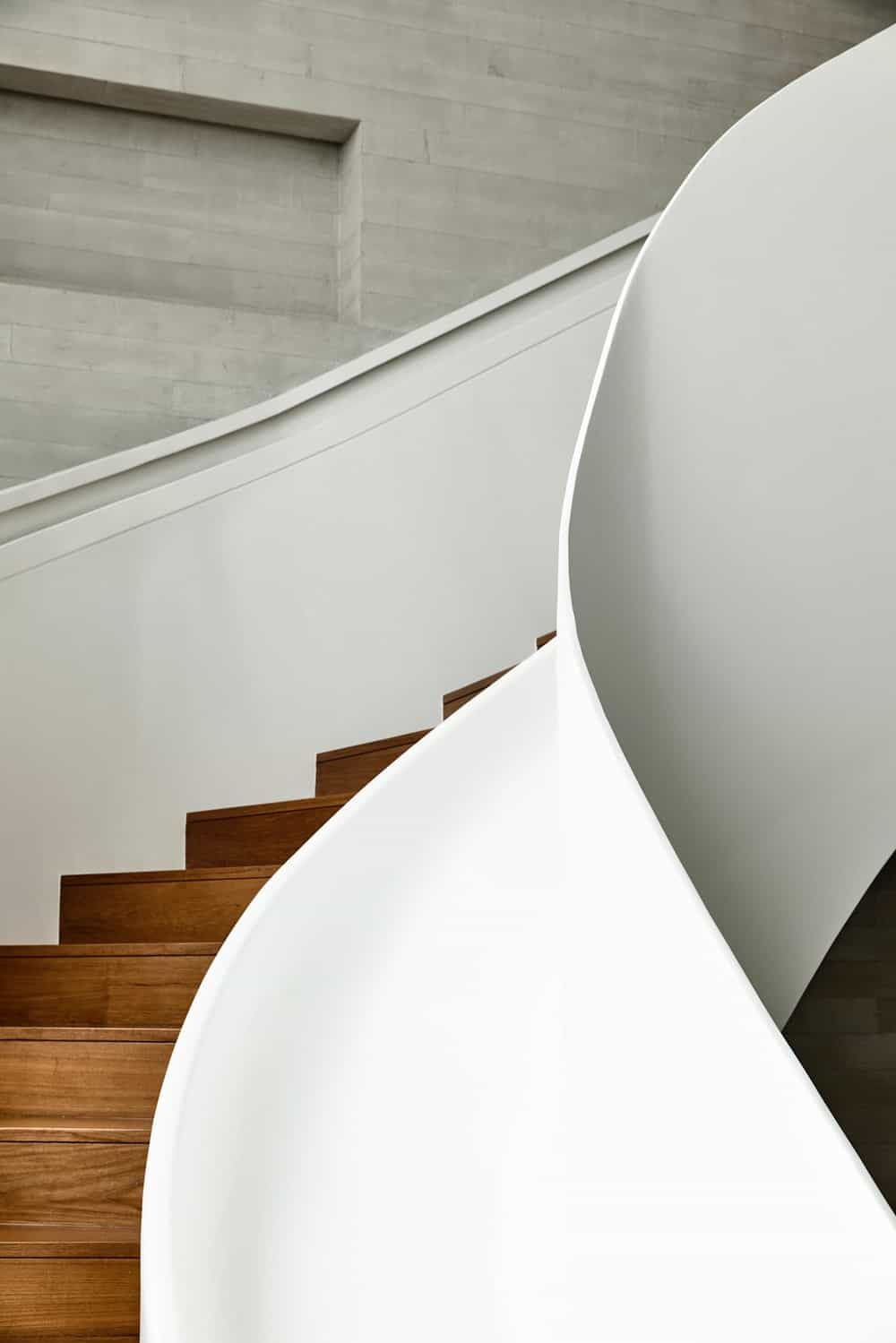 This is a view of the curved staircase from the ground level showing a smooth curve.