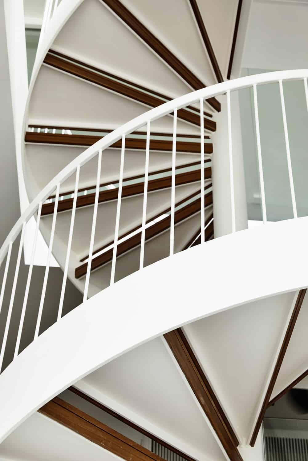 This is the spiral staircase going from the second level to the third level with thin railings on the side.