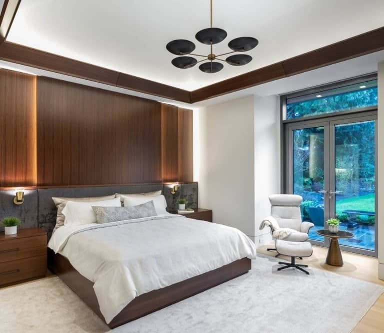 The primary bedroom has a built-in wooden bed that is attached to the wood-paneled wall.