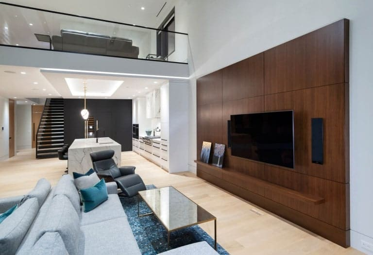 On the other side of the family room is a large wood-paneled wall with a wall-mounted TV.