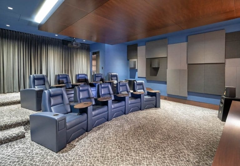 This other view of the home theater showcases more of the two rows of gray leather theater seats.