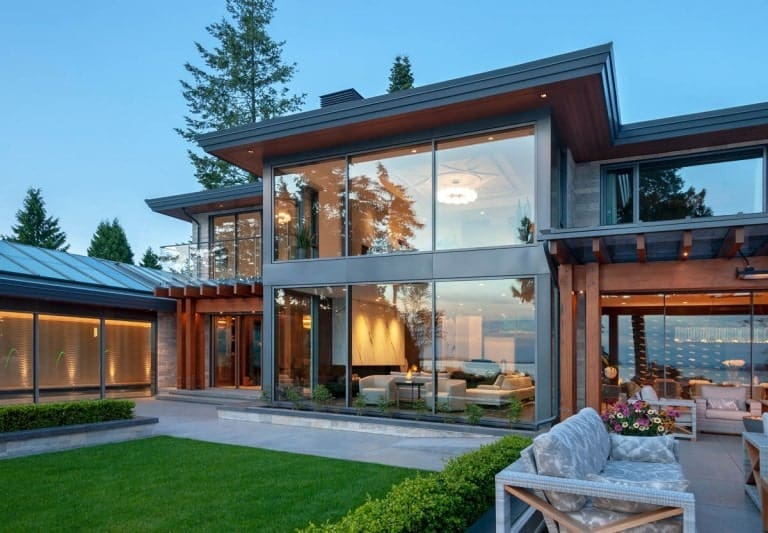 This is an exterior view of the house showcasing the large glass walls on all levels.