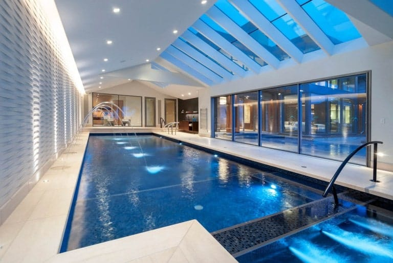 This is the large indoor pool with a cathedral ceiling that has a row of skylights and glass walls.