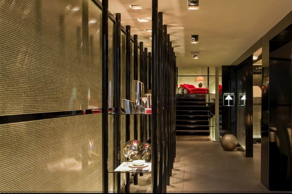 Armani Casa with ambient lighting and paneled walls fitted by fitted by black polished aluminum.