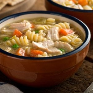 A bowl of freshly-cooked chicken noodle soup.