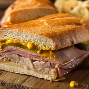 S slice of traditional Cuban sandwich with pork and mustard.