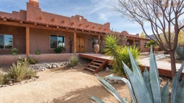 This is a view of the front of the house that has an earthy tone to its exterior walls to contrast the light desert landscape. Image courtesy of Toptenrealestatedeals.com.