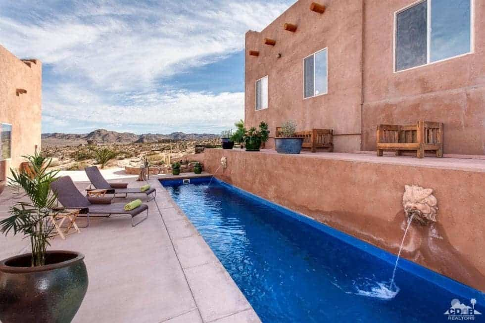 This is a look at the saltwater swimming pool with fountains, lounges and various sitting areas around the long and narrow pool. Image courtesy of Toptenrealestatedeals.com.