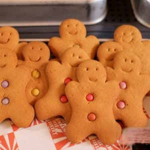 A set of gingerbread man cookies on display at a store.