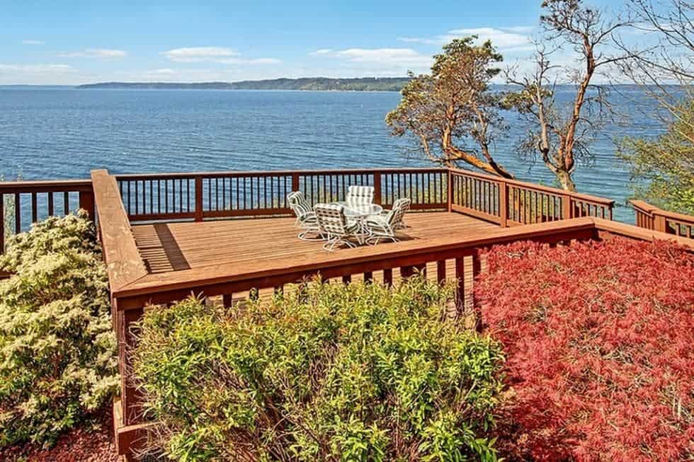 This is the wooden deck terrace of the mansion fitted with a comfortable sitting area to better enjoy the sweeping view of the Puget Sound. Image courtesy of Toptenrealestatedeals.com.