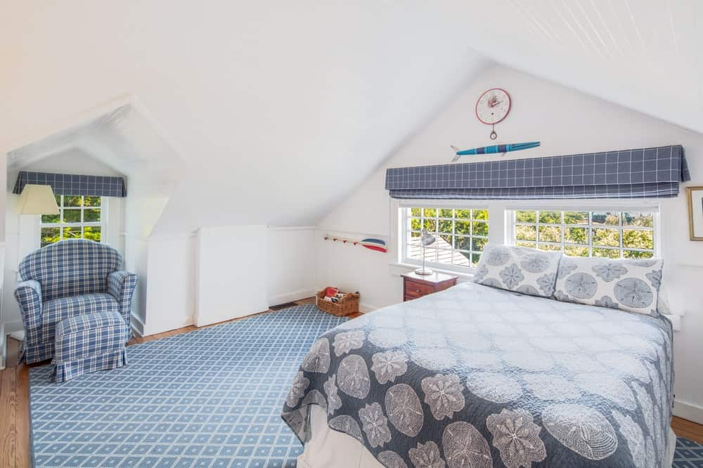 This other look at the bedroom shows that it has a low cathedral ceiling that blends well with the beige tone of the walls. Image courtesy of Toptenrealestatedeals.com.