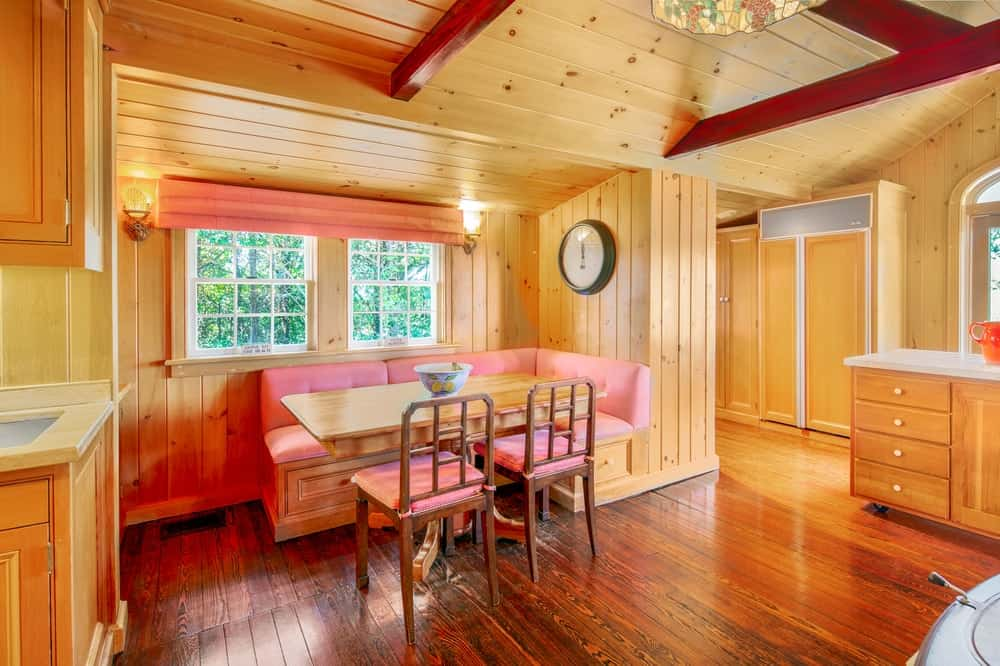 This is the breakfast nook with a built-in wooden bench for a booth-style look paired with the wooden dining table. Image courtesy of Toptenrealestatedeals.com.