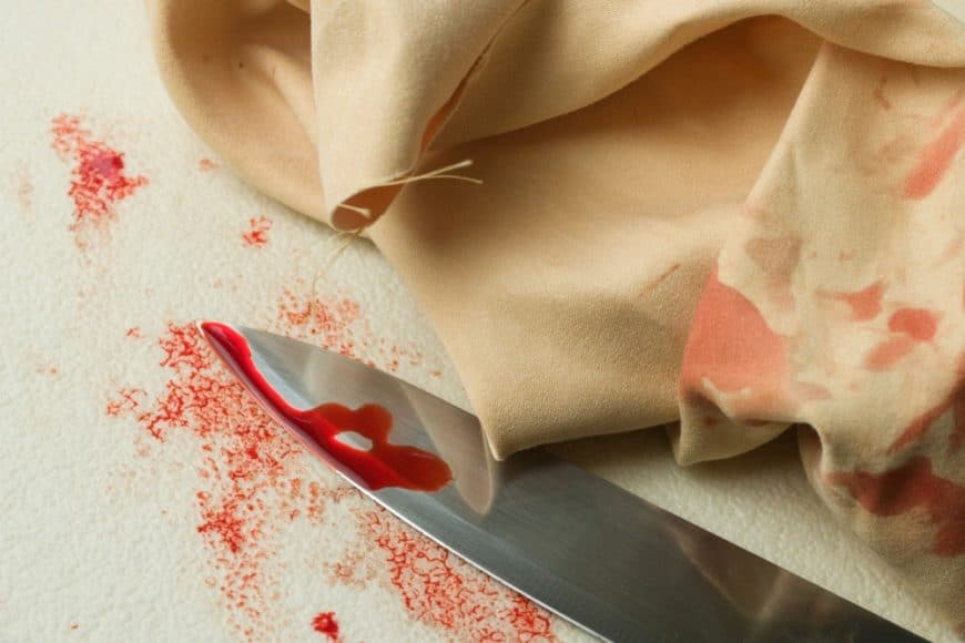 Blood stains on knife and cloth.