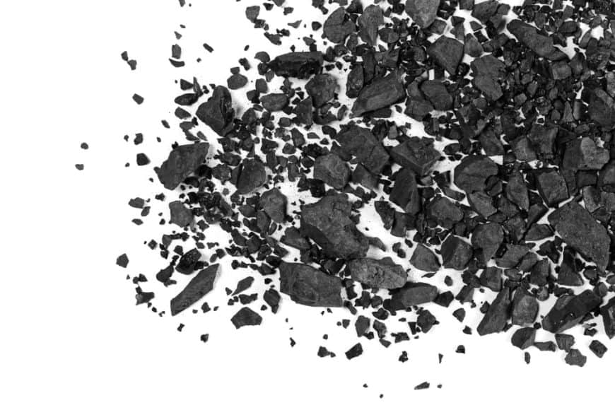 Charcoal pieces against a white background.