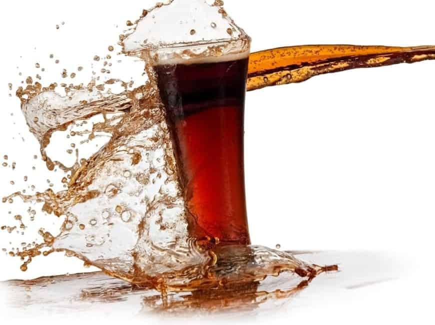 Soda splashing out of a glass.