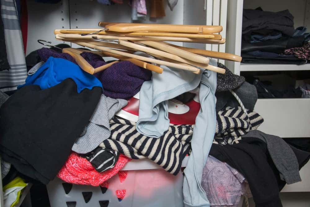 A closet space in the middle of general cleaning.