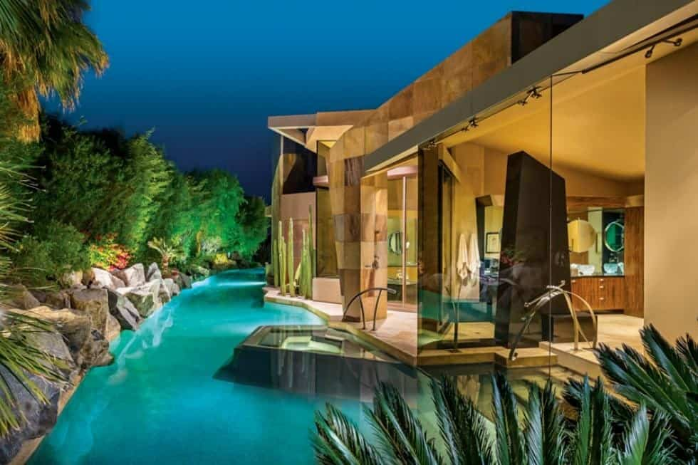 This is a look at the swimming pool that runs to the side of the house. It has its own lighting making it glow to complement the beige exteriors of the house. Image courtesy of Toptenrealestatedeals.com.