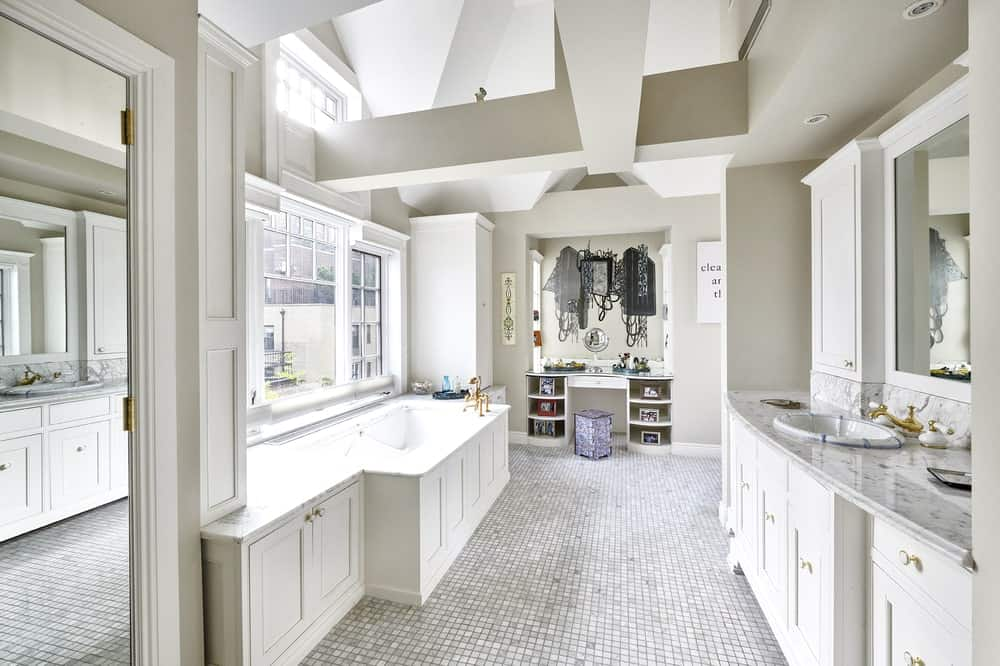 This is the brilliant kitchen with bright white cabinetry to match the walls and ceiling. Image courtesy of Toptenrealestatedeals.com.