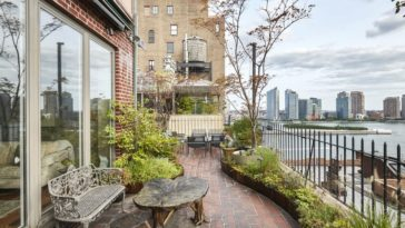 This is the part of the wrap-around terrace with a sitting area adorned by potted plants and brick walls. Image courtesy of Toptenrealestatedeals.com.