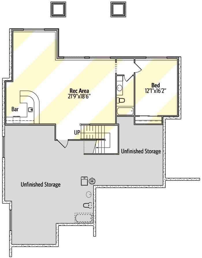 Lower level floor plan with another bed and a recreation room with a bar.