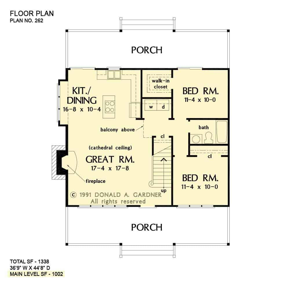Main level floor plan of a two-story 3-bedroom The Shady Grove cabin home with great room, shared kitchen and dining area, two bedrooms, and front and rear porches.