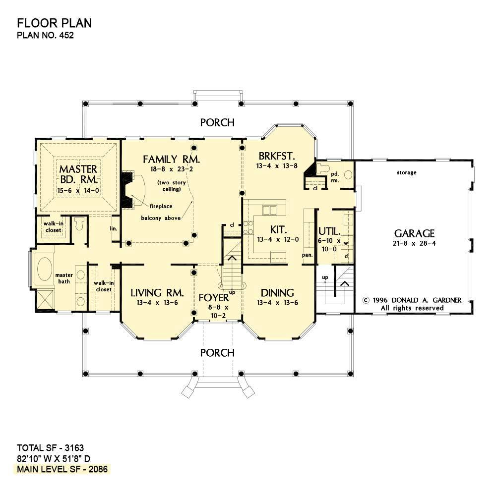 Main level floor plan of a two-story 4-bedroom The Arbordale Farmhouse with living room, formal dining room, family room, kitchen with breakfast nook, primary suite, and wide porches.