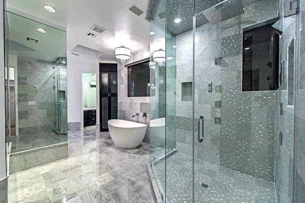 This is the bathroom that has a glass-enclosed walk-in shower area and a freestanding bathtub on the far corner. Image courtesy of Toptenrealestatedeals.com.