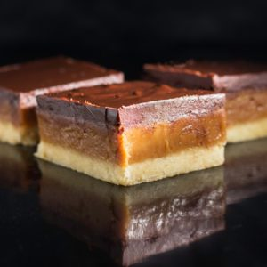 Three slices of decadent millionaire bars.