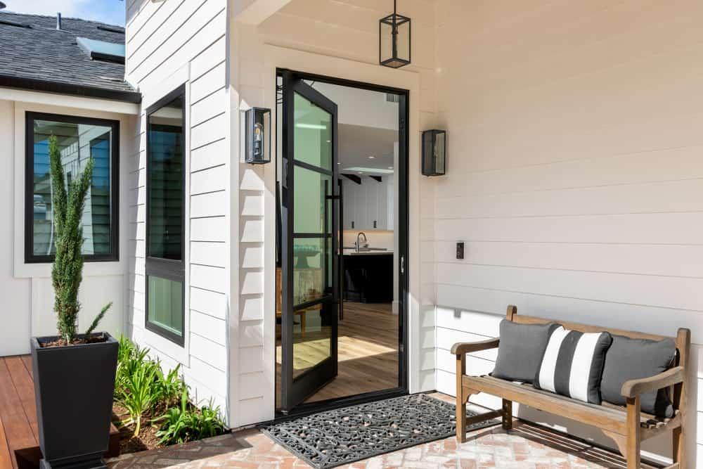 Glass pivot front door