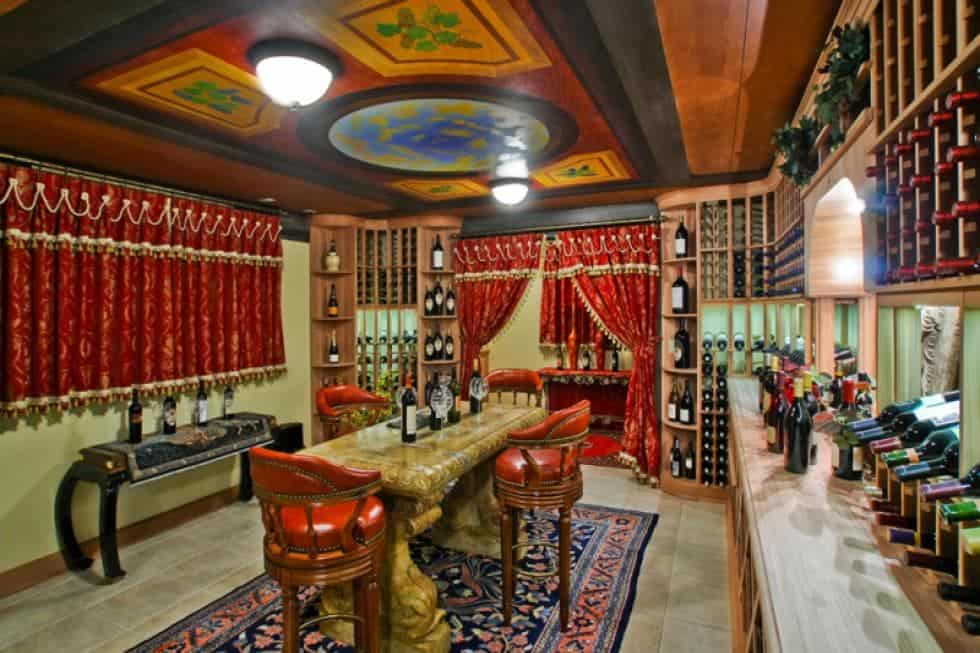 This is the large wine cellar with its own tasting area in the middle surrounded by colorful patterns on the floor, walls and ceiling. Image courtesy of Toptenrealestatedeals.com.
