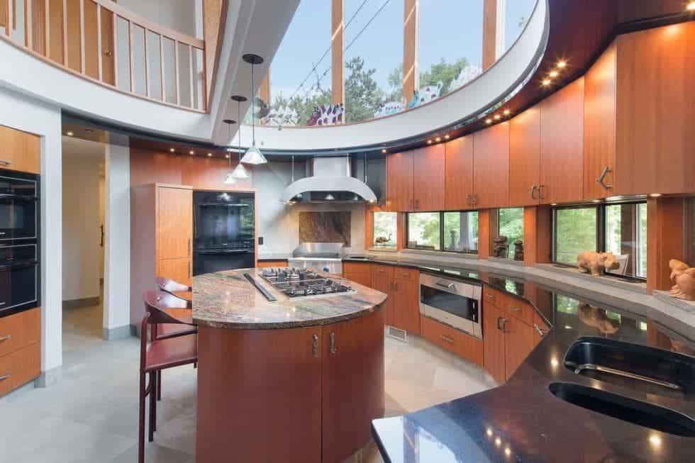This is the semi-circular kitchen with a curved cabinetry lining the wall paired with a circular kitchen island in the middle. These are then illuminated by the transom windows above. Image courtesy of Toptenrealestatedeals.com.